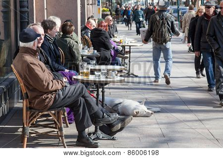 Helsinki, Finland - March 29:the People Having A Rest Behind A Little Table Of Street Cafe Of Helsin