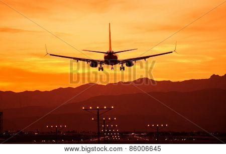 Landing Airplane At Sunset