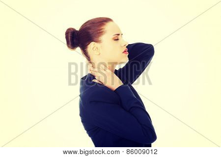 Business woman with back neck pain.
