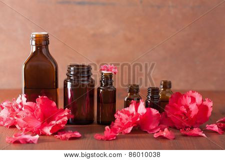 essential oil azalea flowers on rustic background