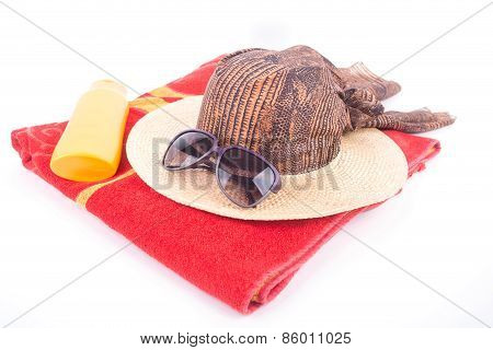 Beach Hat And Sunglasses On Towel