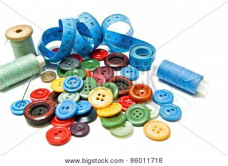 Many Different Buttons And Spools Of Thread