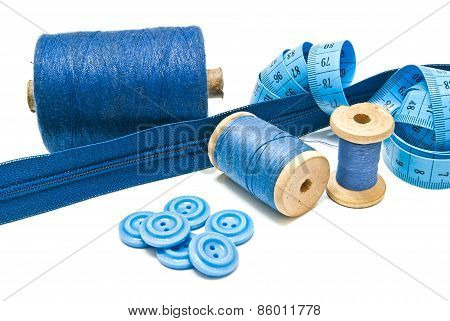 Blue Zipper And Spools Of Blue Thread