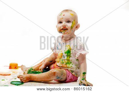 Baby Soiled By Paint Lodges On A Light Background