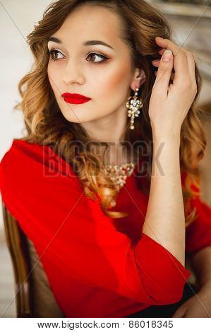 The Girl In A Red Dress With Gold Costume Jewelry