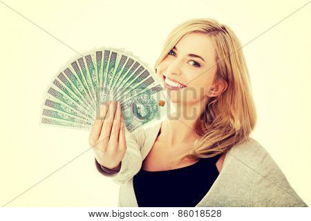Woman with polish money in hand