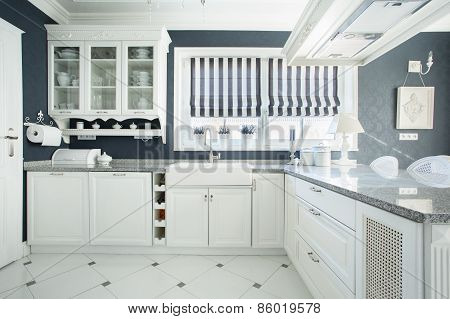 Interior Of White And Grey Kitchen