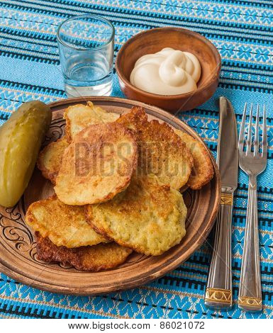 Traditional Ukrainian Homemade Potato Pancakes (draniks) A Glass Of Vodka And Salted Cucumber