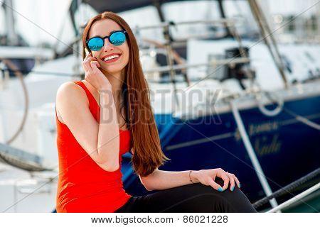 Woman sitting near the yachts
