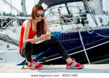 Woman sitting near the yachts