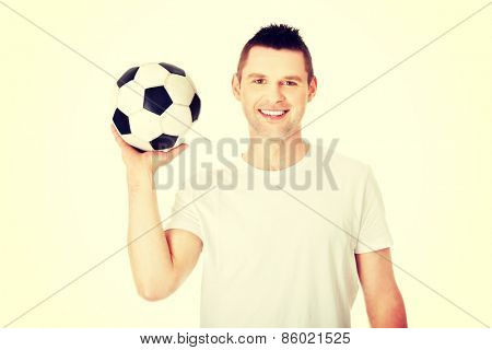 Yaong man with soccer ball in hand