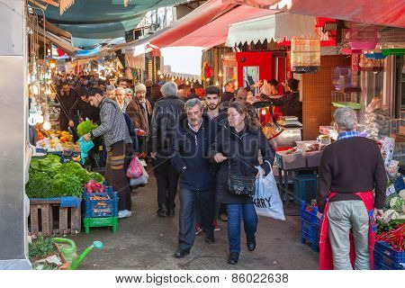 Turkish Bazaar Street View With Sellers And Crowd Of Buyers