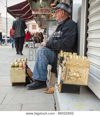 Senior Shoeshine Man Sitting On His Workplace