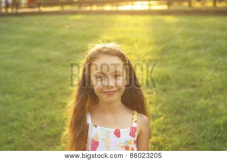 Pretty little girl playing in the sunset