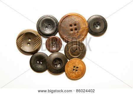 A Lot Of Vintage Buttons On  White Background
