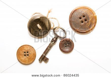 A Lot Of Vintage Button, Old Key With Affection For Him A Button On A White Background