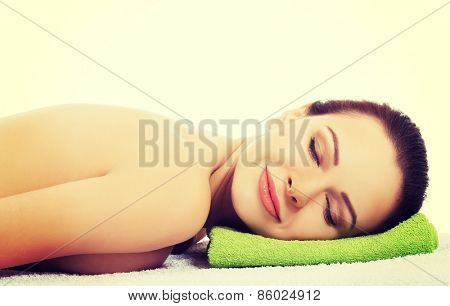 Girl on a stone therapy, hot stone massage.