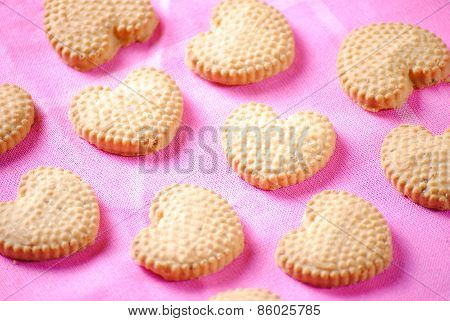 Heart shaped cookies on pink cloth