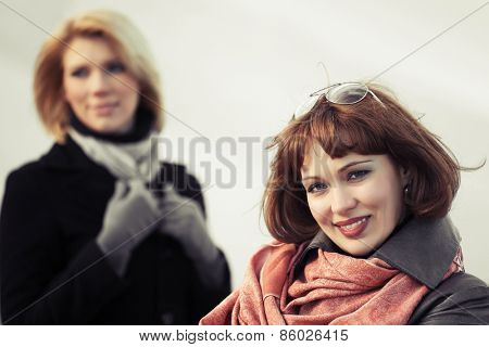 Two happy young fashion women outdoor