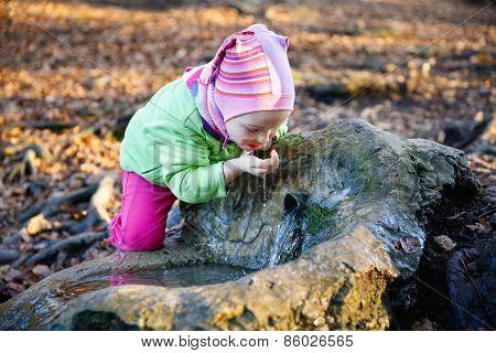Thirsty Girl Drinking Spring Water