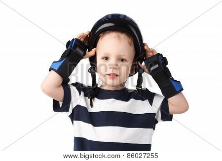 Little Boy In A Protective Wrist Pads Puts Or Removes The Protective Helmet