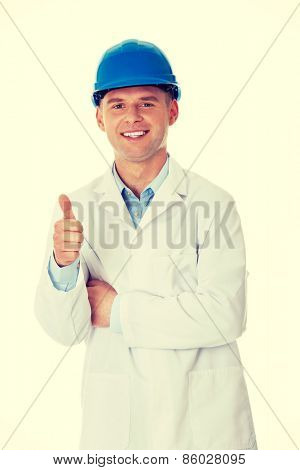 Man in a lab coat and helmet, engineer, teacher or chemical gesturing OK