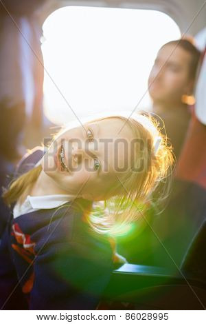 Family of little girl and her father traveling on train