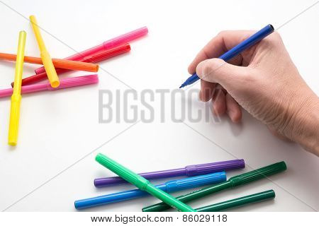 the man's hand, ready to draw a picture