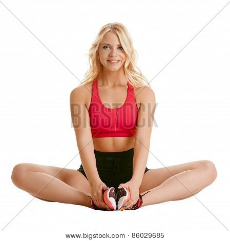 Image of charming blonde training stretching