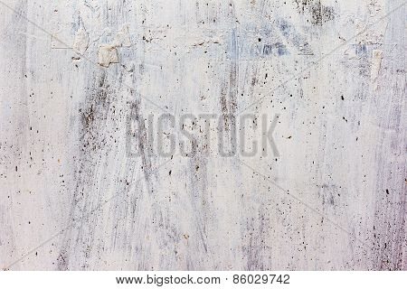 Dirty Concrete Wall With Yellow Streaks Of Water, Cracks And Scratches. Grungy Concrete Surface. Gre