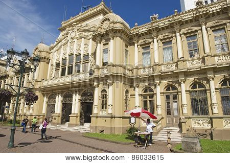 People walk in front of the old Post Office building in San Jose, Costa Rica.