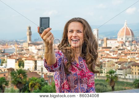 Happy Young Woman Making Selfie Against Panoramic View Of Floren