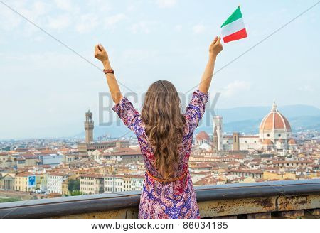 Young Woman With Flag Rejoicing Against Panoramic View Of Florence, Italy