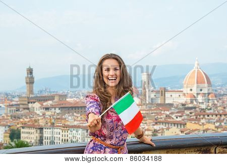 Happy Young Woman Showing Flag Against Panoramic View Of Florenc