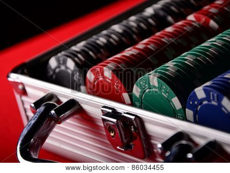Stack of chips in the metal case. Poker. Blackjack. Roulette.