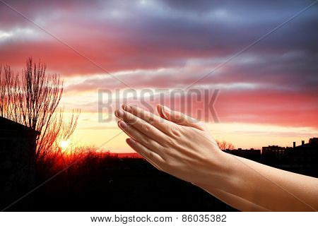 Human hands on sky background