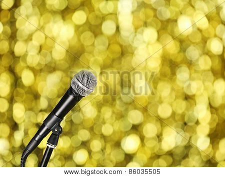 Microphone on bright yellow background