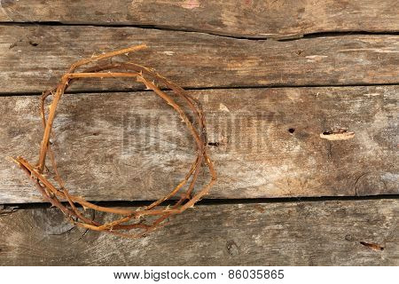 Crown of thorns on old wooden background