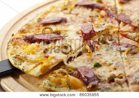 Pizza with Sausage, Olives and Gouda