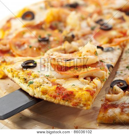 Seafood Pizza with Mozzarella, Various Seafood, Tomato, Black Olives and Shellfish