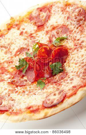 Pizza made with Salami, Mozzarella and Tomato Sauce