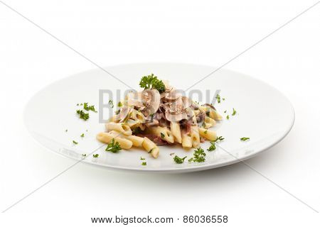Pasta Penne with Mushrooms and Parmesan Cheese. Garnished with Parsley