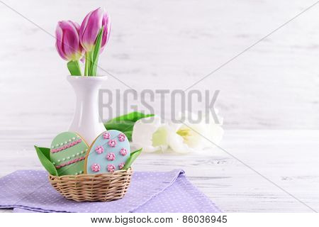 Delicious Easter cookies on table on light background