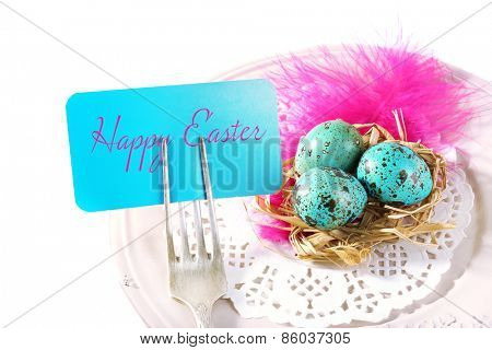 Easter table setting with empty card and Easter eggs, isolated on white