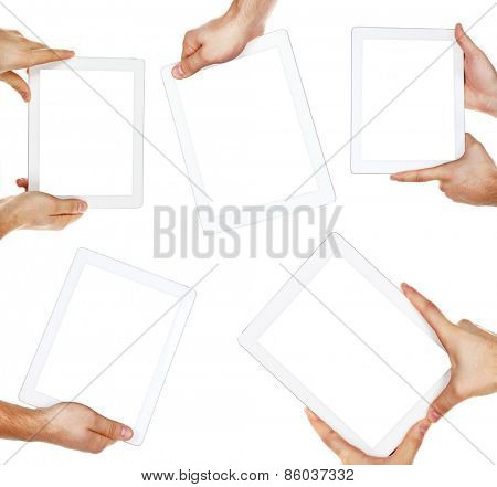 Hands holding tablets isolated on white