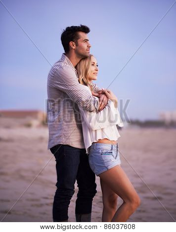 two romantic lovers on the beach at twilight shot with selective focus