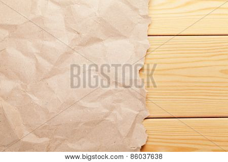 Cardboard paper over wooden background. Top view with copy space