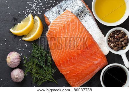 Salmon and spices on stone table. Top view