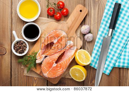 Salmon and spices on wooden table. Top view