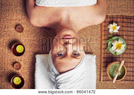 Portrait of woman lying on massage table
